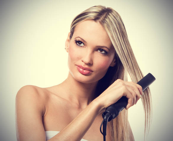 young-beautiful-girl-making-hairstyle-with-hair-iron